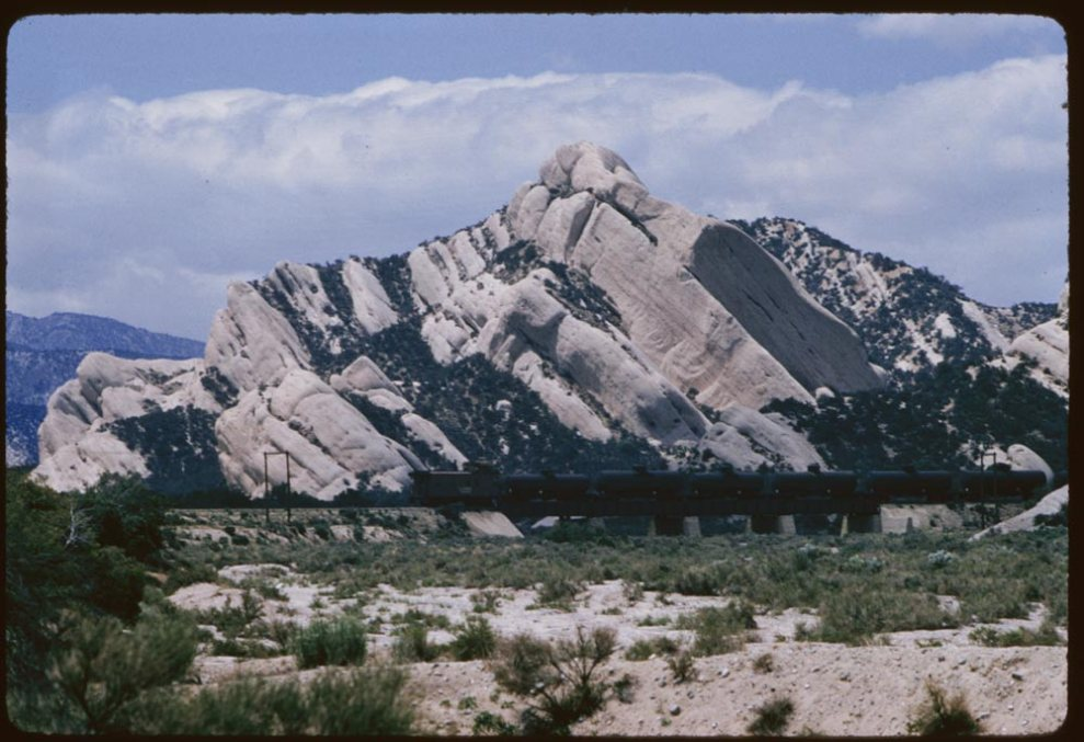 ID: P09289. 1957 May 14. Slanting sandstone rocks along AT & SF in Cajon Canyon, CA. Retrieved from: http://www.dlib.indiana.edu/collections/cushman/